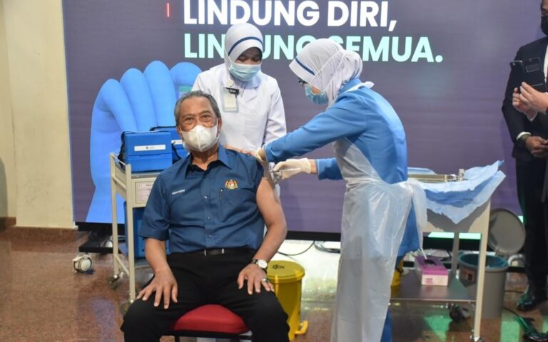 Muhyiddin: Govt considers action against anti-vaxxers as registrations fall short of 80% population target